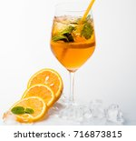 Small photo of Alcoholic beverage and lemon fruit at restaurant. Cocktail isolated on white background. Drink and food. Fruit slice and cocktail glass at bar. Party and summer vacation.
