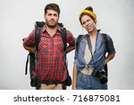 distressed female and male... | Shutterstock . vector #716875081