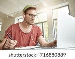 clever student wears... | Shutterstock . vector #716880889
