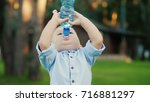 funny kid 1 year is drinking... | Shutterstock . vector #716881297