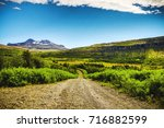 mountain iceland road and... | Shutterstock . vector #716882599