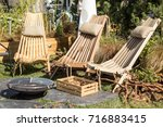 a wooden chair on the terrace ... | Shutterstock . vector #716883415