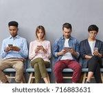 international group of four... | Shutterstock . vector #716883631