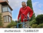 happy senior man dressed in red ... | Shutterstock . vector #716886529