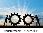 silhouette of two people who... | Shutterstock . vector #716890141