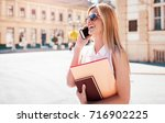 young smiling woman talking on... | Shutterstock . vector #716902225
