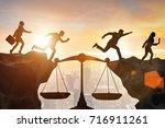 business people in fair... | Shutterstock . vector #716911261