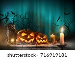 halloween pumpkins on wooden... | Shutterstock . vector #716919181