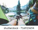 young woman traveler sitting...   Shutterstock . vector #716923654