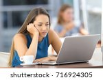 bored woman watching on line... | Shutterstock . vector #716924305