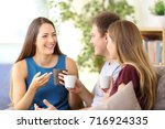 three happy friends talking and ... | Shutterstock . vector #716924335