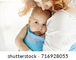 close up of little kid with big ... | Shutterstock . vector #716928055