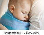 close up portrait of innocent... | Shutterstock . vector #716928091