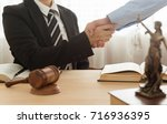 attorney shaking hand with... | Shutterstock . vector #716936395