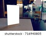 mock up menu frame standing on... | Shutterstock . vector #716940805