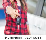 hand holding the remote control ... | Shutterstock . vector #716943955