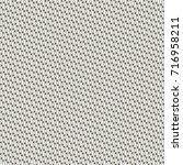 abstract tweed background....   Shutterstock .eps vector #716958211
