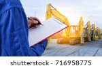 worker checking document in... | Shutterstock . vector #716958775