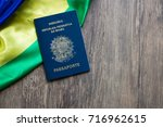 brazilian passport on wooden... | Shutterstock . vector #716962615