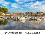 trouville and touques river in... | Shutterstock . vector #716963365