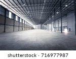 empty warehouse or storage room ... | Shutterstock . vector #716977987