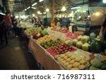 blur fruit shop on the shelves... | Shutterstock . vector #716987311