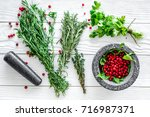 Berries And Herbs In Mortar Fo...