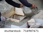 worker pouring cement in... | Shutterstock . vector #716987671