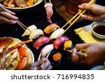 eating japanese food healthy... | Shutterstock . vector #716994835