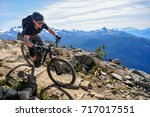 mountain biking in whistler ... | Shutterstock . vector #717017551