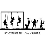 children silhouettes playing... | Shutterstock .eps vector #717018055