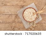 oat flakes in bowl with spoon...   Shutterstock . vector #717020635