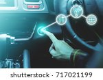 finger pressing the start stop... | Shutterstock . vector #717021199