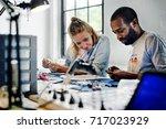 technicians working on... | Shutterstock . vector #717023929