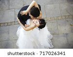 young asian bride and groom... | Shutterstock . vector #717026341