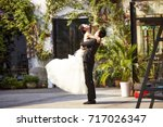 asian newly wed bride and groom ...   Shutterstock . vector #717026347