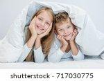 two happy sibling children... | Shutterstock . vector #717030775