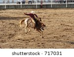 saddle bronc riding rodeo... | Shutterstock . vector #717031