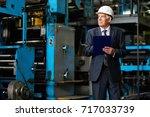 senior investor in suit and... | Shutterstock . vector #717033739