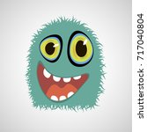 cheerful monster on a gray... | Shutterstock .eps vector #717040804