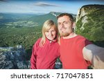 two hikers making selfie on a... | Shutterstock . vector #717047851