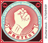 raised protest human fist.... | Shutterstock .eps vector #717049459