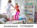 cute fair haired little sisters ... | Shutterstock . vector #717050839