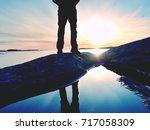 tall hiker in dark sportswear... | Shutterstock . vector #717058309