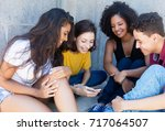 group of international young... | Shutterstock . vector #717064507