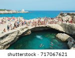 Small photo of Roca Vecchia, Italy - August 28, 2017: People sunbathing and swimming in a natural pool near Otranto on the Adriatic coast.