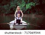sweet girl staying near rowing... | Shutterstock . vector #717069544