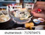 oysters   Shutterstock . vector #717076471
