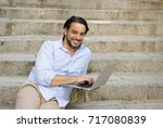 young attractive latin man... | Shutterstock . vector #717080839