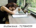 business woman tired fell... | Shutterstock . vector #717084559